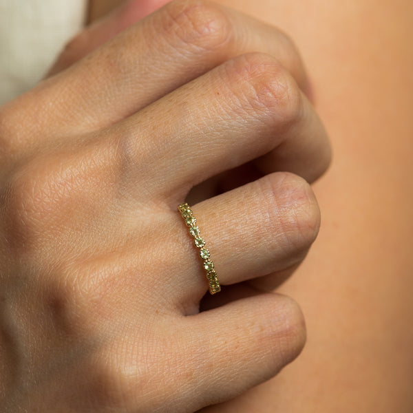Leonore Peridot god ring worn by hand model