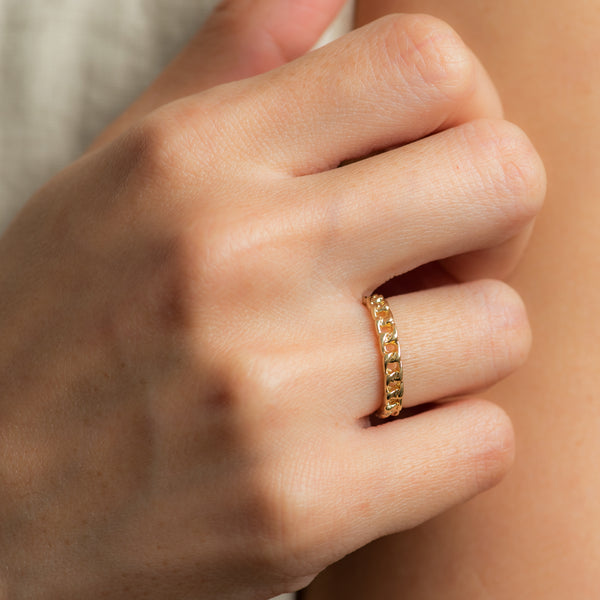 Gold Chain ring work by hand model