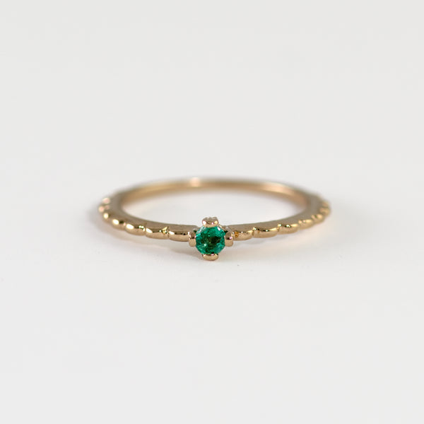 Emery Emerald on gold ring worn by hand model