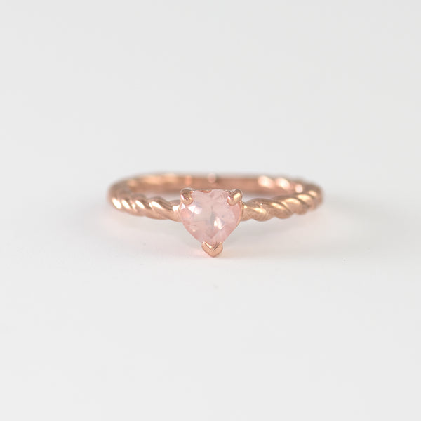 Octavia Rose Quartz on Rose gold ring worn by hand model