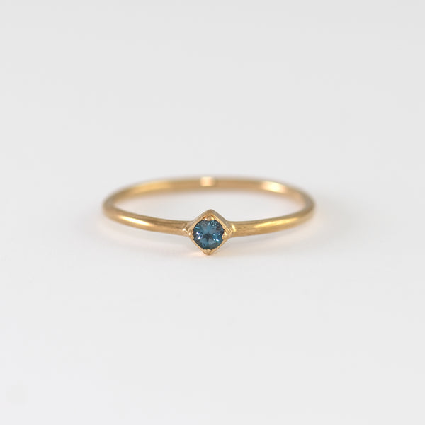 Blue topaz on gold band Jacqueline