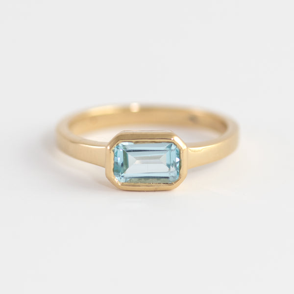 Blue Topaz on gold ring Nyla