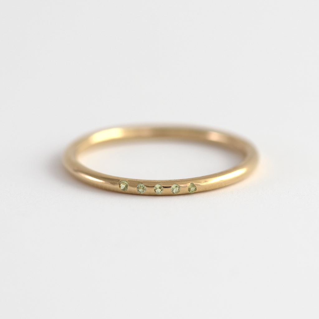 Oliana Peridot on gold ring