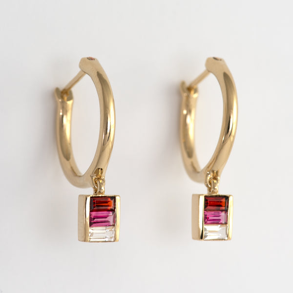 Quinn gold hoop earrings with baguette stones