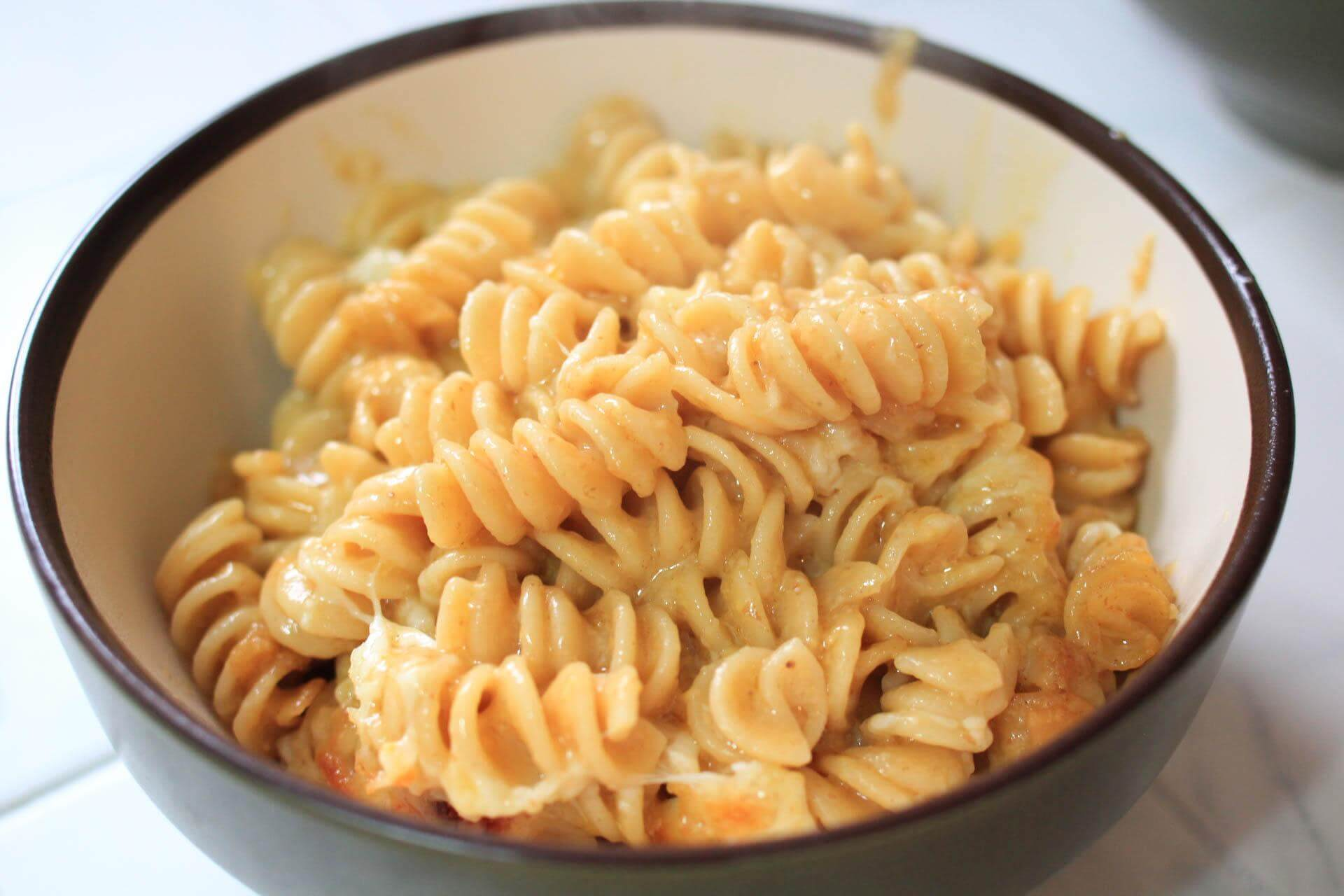 Unseasoned macaroni and cheese in a bowl