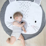 Baby sleeping on round Bunny playmat