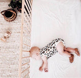 Sleeping baby wearing Amalfi sandals in vintage brown