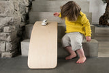 Wobbel Original balance board girl playing