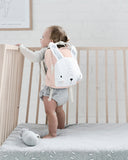 Baby wearing a Mister Fly Kids Pink Bunny backpack