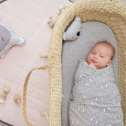 Baby swaddled in BunBun cotton jersey blanket with bunny print