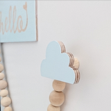 close up of a wooden cloud hook light blue