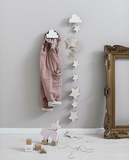 cloud shaped hanging wall hooks with clothes and decorations hanging off them