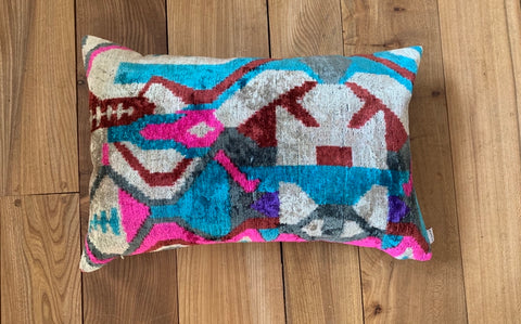 Geometric velvet ikat lumber cushion