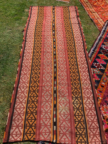 Kilim rug in orange and terracotta colours