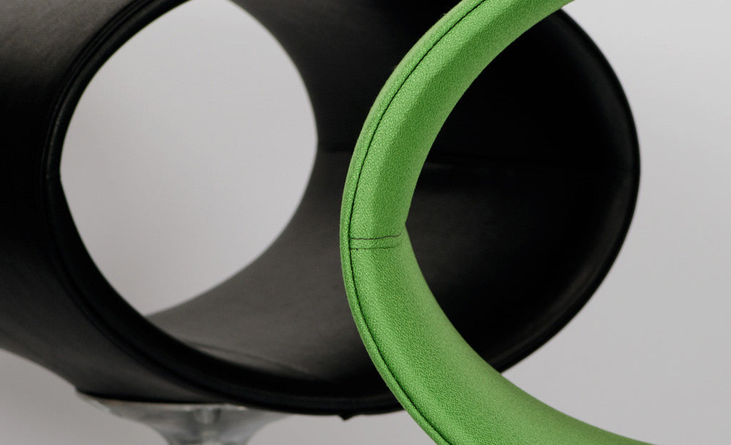 orbit cat bed in stem super fabric with black recycled leather orbit in the background