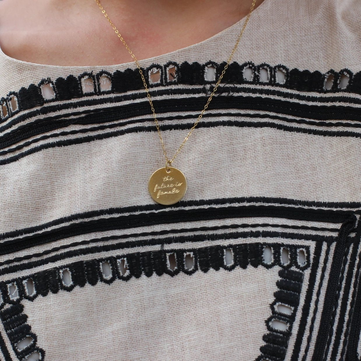 Bird + Stone 'The Future is Female' Necklace in Gold on Dress