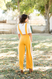 Mustard Jumpsuit w/ white t-shirt