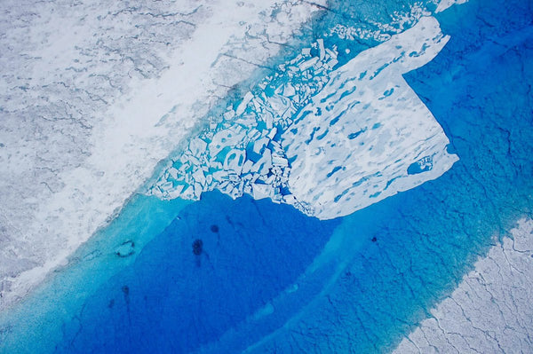 Supraglacial lake (with lake ice) on the Greenland Ice Sheet