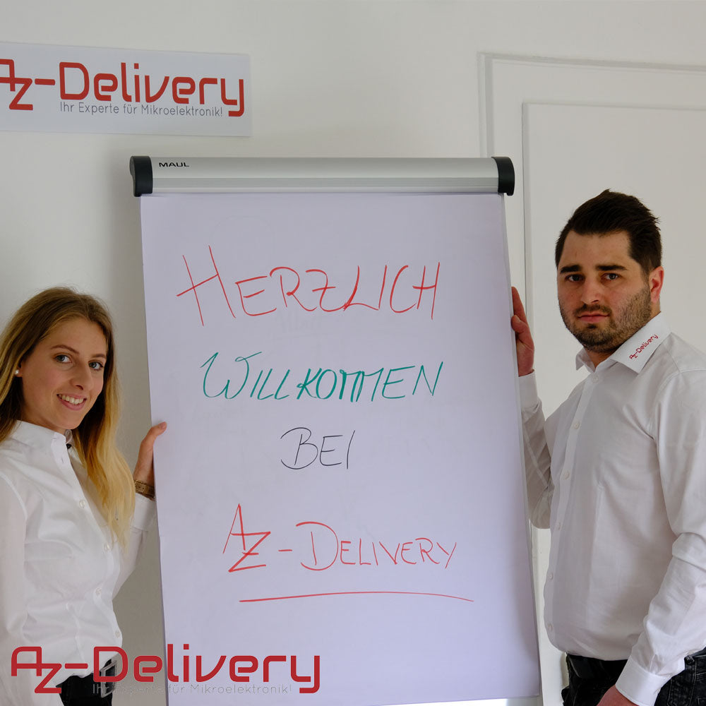 two az delivery employees with welcome written on table