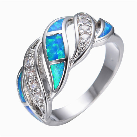 Intertwining Crystal and Fire Opal Ring