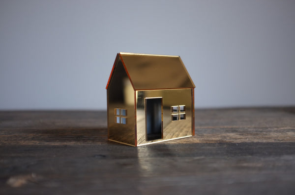 Mirrored House in Gold