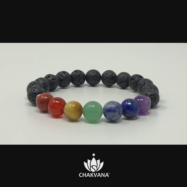 Video of CHAKVANA 7 Chakras Bracelet. 7 individual round genuine gemstone beads on the top of the bracelet represent each of the 7 major chakras. The remainder of the bracelet consists of natural round black lava rock beads.