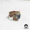 Ring with polished Amethyst oval gemstone and decorative braided multi-metal ring band. – Chakvana.com