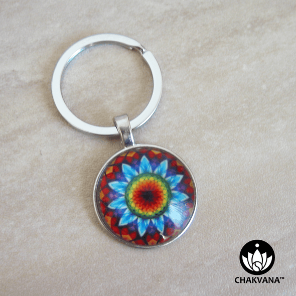 Keychain ring showcasing a vibrant Flower Mandala design inside of a magnifying glass cabochon. – Chakvana.com