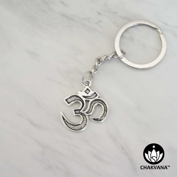 Silver metal alloy keychain featuring a sacred Om symbol. – Chakvana.com