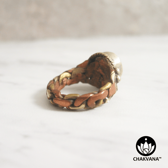 Ring with Om symbol, turquoise gemstone, and braided pattern multi-metal band. – Chakvana.com