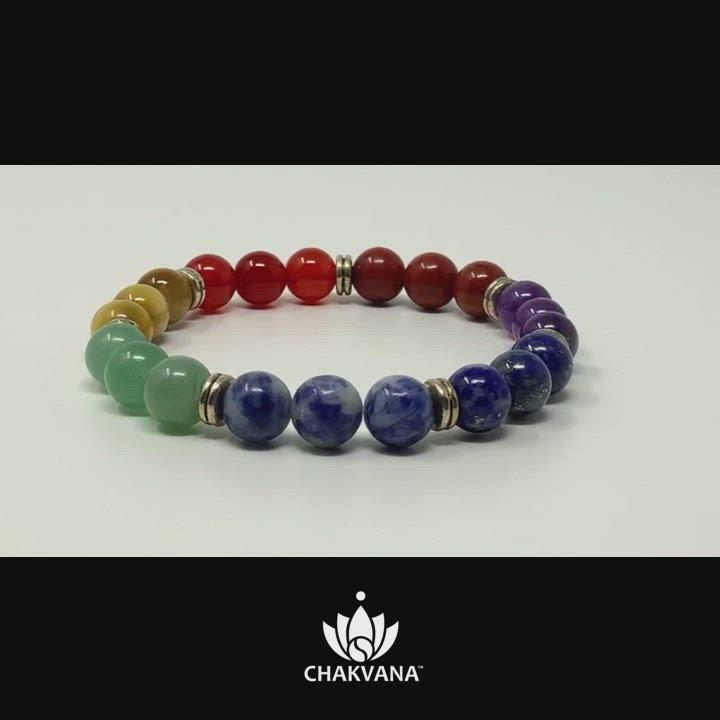 Video of 7 Chakras Bracelet. Bracelet has 7 sets of round gemstone beads, 3 beads per set, and each set represents one of the 7 major chakras. The sets of beads are separated by silver spacer beads. Chakra healing bracelet. Reiki charged. Premium Yoga Jewelry. Hand made in the U.S.A. by CHAKVANA.
