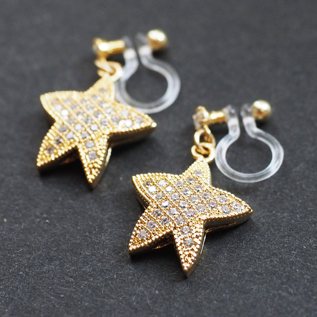 Sparkly cubic zirconia star invisible clip on earrings!