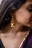 Layered emerald jhumkas