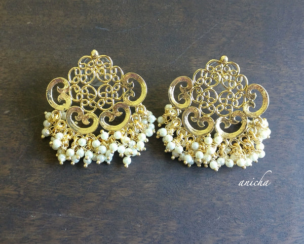 Spiral gold pearl earrings