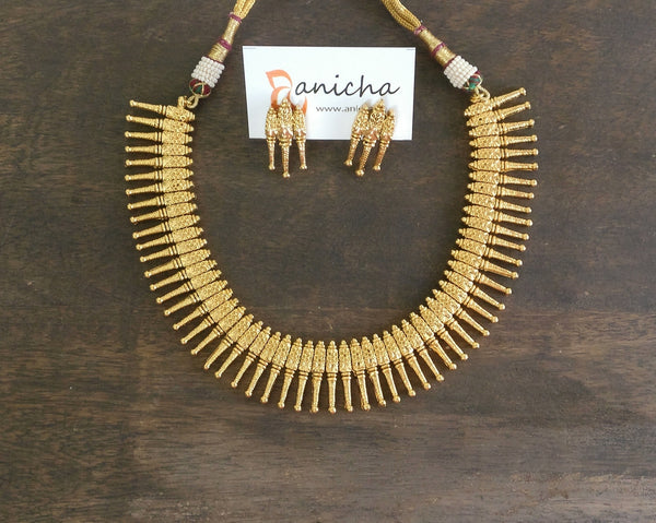 Gold spikes necklace set - Anicha
