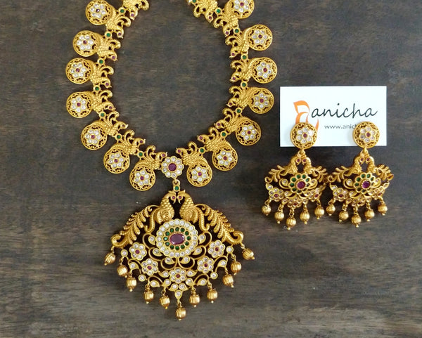 Matte gold peacock flower necklace set - Anicha
