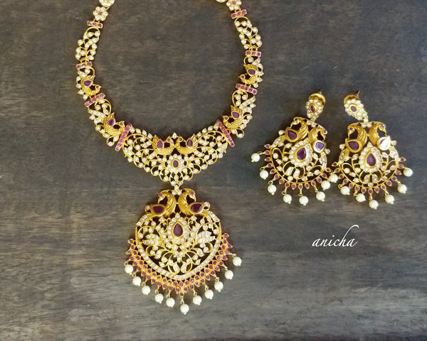 White-ruby peacock stone necklace set - Anicha