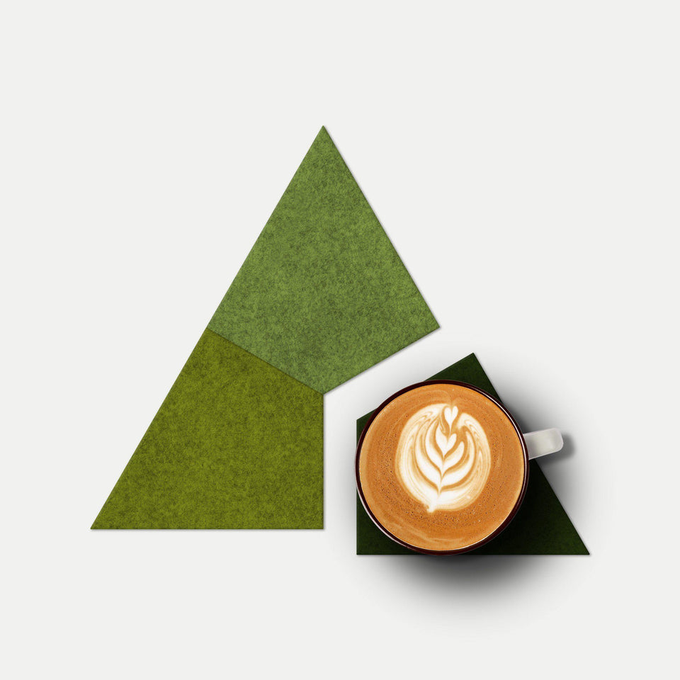 Modern trivet and coaster set made from green felt in the UK