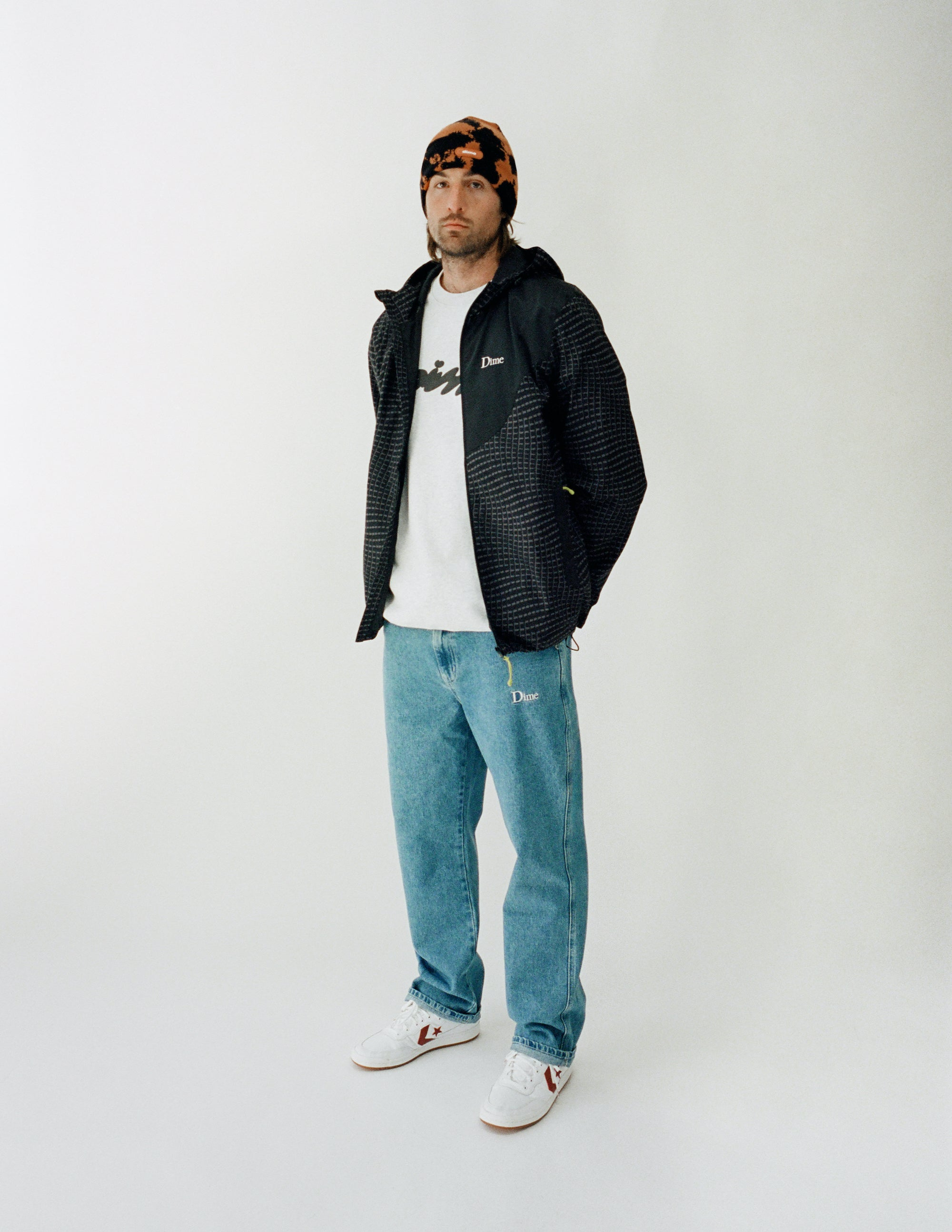 Dime Spring 2021 Lookbook Warp Shell Windbreaker in Black styled with Cotton Denim Pants in Lightwash, Bubbly Crewneck in Ash Grey and Sly Beanie in Orange