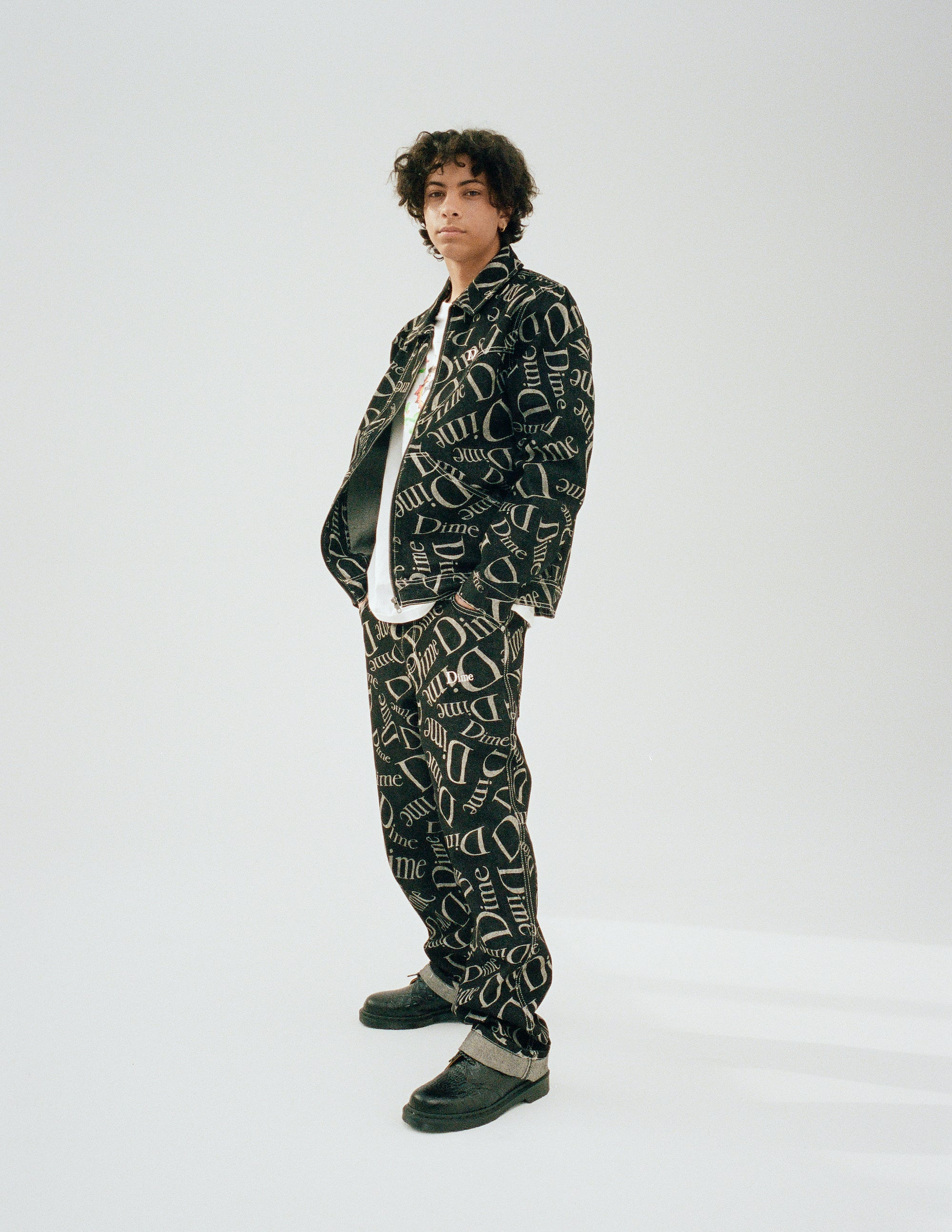 Dime Spring 2021 Lookbook Online Exclusive Cotton Denim Chore Jacket in Black All Over Logo Print styled with Denim Pants in Black All Over Logo Print and Swan T-Shirt in White