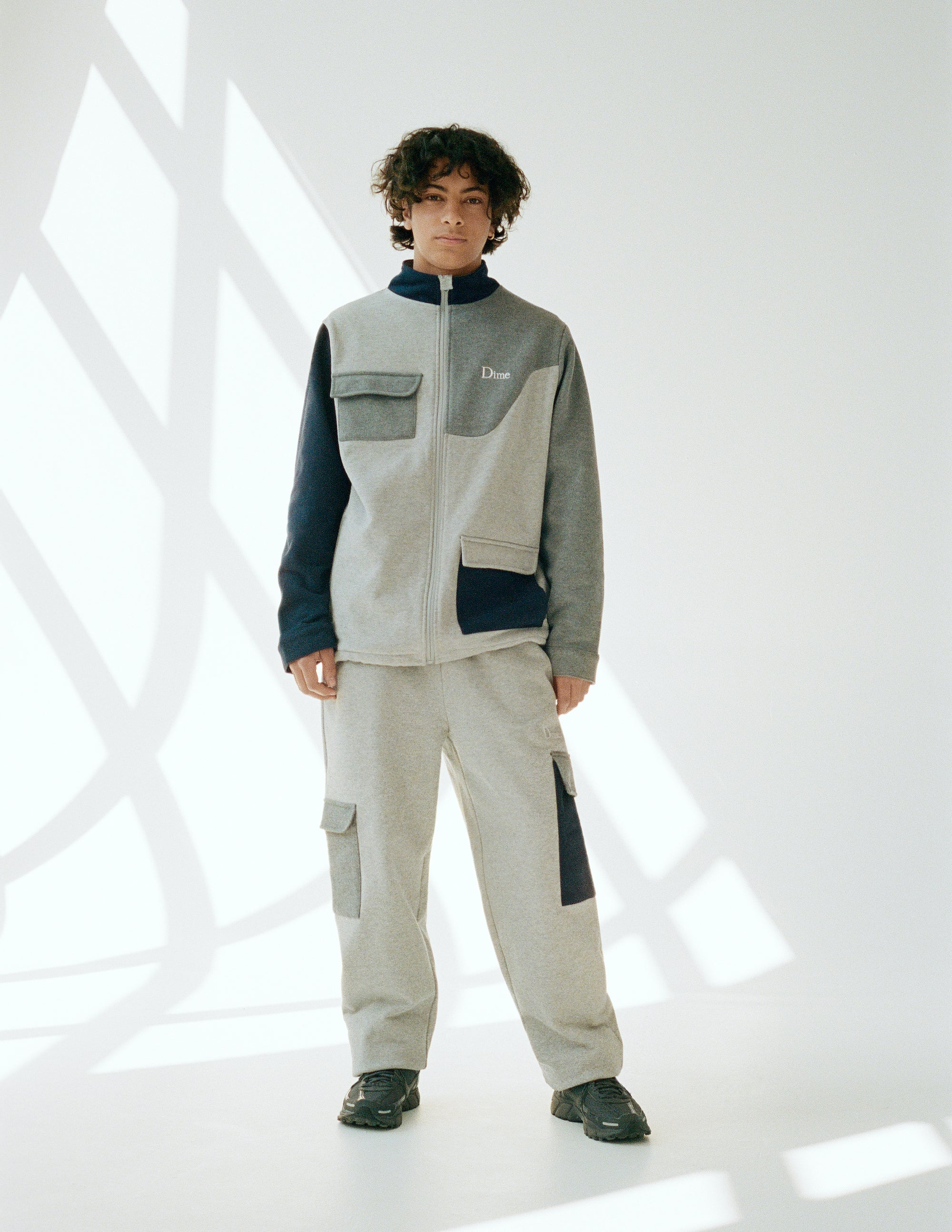 Dime Spring 2021 Lookbook Brushed Cotton Track Jacket in Heather Multi styled with Brushed Fleece Cargo Pants in Ash Gray