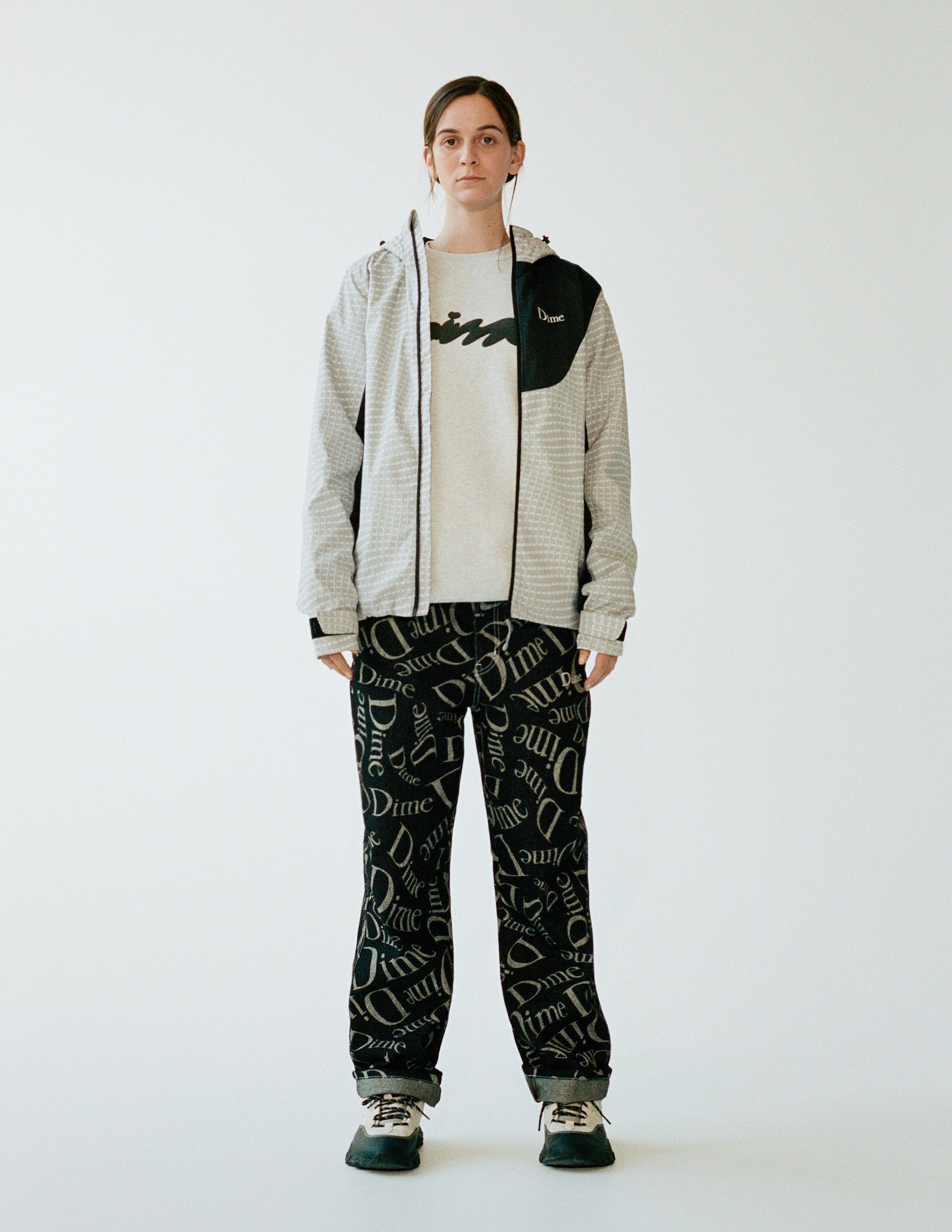 Dime Spring 2021 Lookbook Warp Shell Windbreaker in Gray styled with Online Exlusive Cotton Denim Pants in Black with an All Over Logo Print and Bubbly Crewneck in Ash Grey