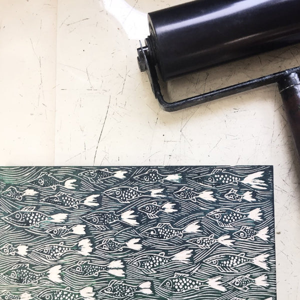 Woodcut and roller ready for printing