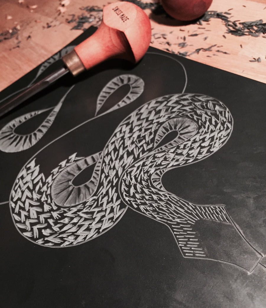 Cutting the lino for the Snake Lino Print by Hex Cavelli