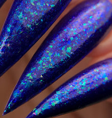 NeVerMind Polish - Le Fay January PPU Blurple polish with auqua flakes close up
