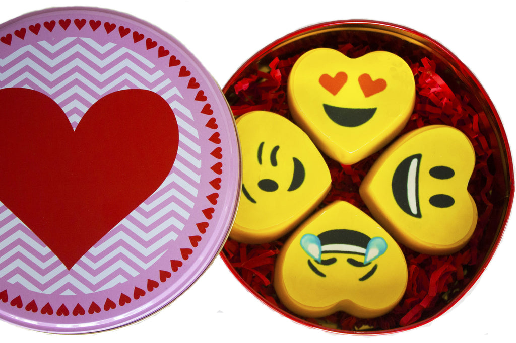 Image of 4 vibrant yellow heart emoji oreos® in a round gift tin for mail delivery from Benedict Treats