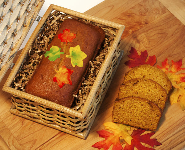 Image of pumpkin bread decorated with candy clay leaves in a cute basket hamper from Benedict Treats