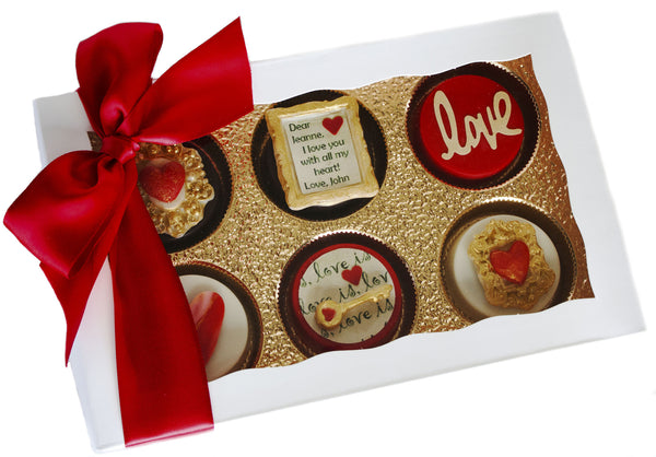 Image of white gift box wrapped with a red satin bow containing gorgeous personalized Valentine's Day chocolate covered Oreos® from Benedict Treats