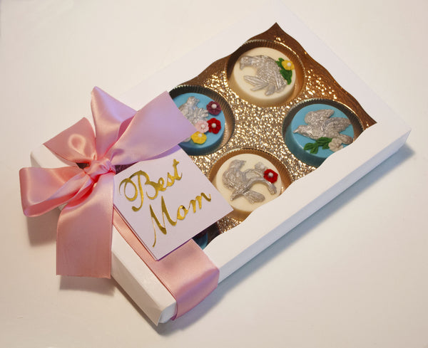 Image of white box containing chocolate covered oreos® with edible silver birds and flowers on top as a cookie delivery gift from Benedict Treats