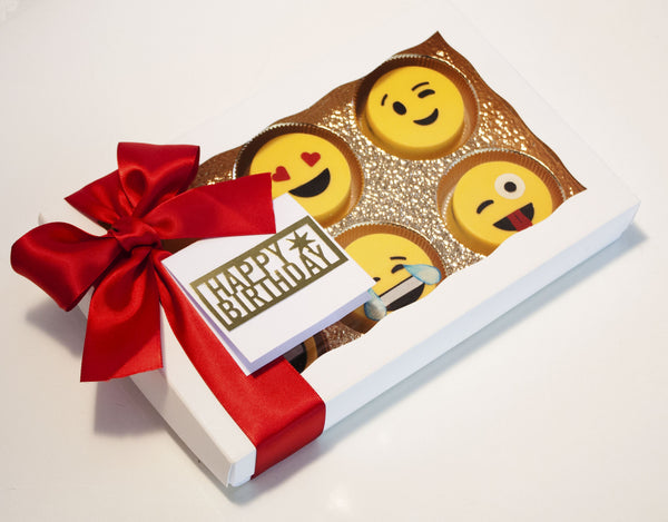 Image of emoji oreos in a nice white gift box with a red satin bow as a cookie delivery gift for a birthday or any occasion from Benedict Treats